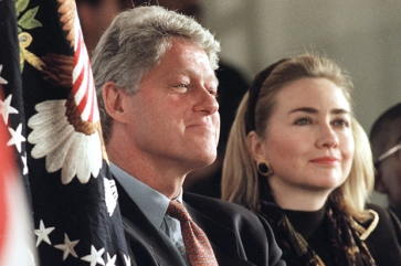 President Bill Clinton and first lady Hillary Rodham Clinton sit with Mario Hood, 12, student body president of the William Jefferson Clinton Elementary Magnet School in Sherwood, Ark., Jan. 4, 1995. Clinton was introduced by the 6th grade student at dedication ceremonies at the school which opened in August 1994. (AP Photo/Greg Gibson)
